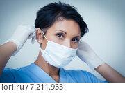 Купить «Female dentist wearing surgical mask», фото № 7211933, снято 16 апреля 2014 г. (c) Wavebreak Media / Фотобанк Лори