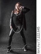 Купить «Young woman in a black clothes with a chain», фото № 7222645, снято 5 апреля 2015 г. (c) Art Konovalov / Фотобанк Лори