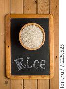 Купить «Рис Басмати в деревянной миске на маленькой меловой доске с надписью мелом», фото № 7225525, снято 1 апреля 2015 г. (c) Лидия Рыженко / Фотобанк Лори