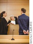 Купить «Judge and lawyer listening the criminal in handcuffs», фото № 7229413, снято 7 августа 2014 г. (c) Wavebreak Media / Фотобанк Лори