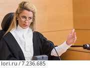 Купить «Stern judge speaking to the court», фото № 7236685, снято 7 августа 2014 г. (c) Wavebreak Media / Фотобанк Лори