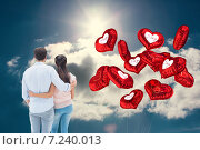 Купить «Composite image of attractive young couple standing with arms around», фото № 7240013, снято 11 декабря 2019 г. (c) Wavebreak Media / Фотобанк Лори