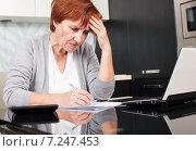 Купить «Elderly woman sorting through her old receipts», фото № 7247453, снято 22 марта 2013 г. (c) Гладских Татьяна / Фотобанк Лори