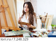 Long-haired female artist paints picture. Стоковое фото, фотограф Яков Филимонов / Фотобанк Лори