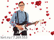 Composite image of geeky hipster playing the guitar. Стоковое фото, агентство Wavebreak Media / Фотобанк Лори