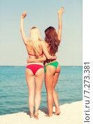 Купить «two young women on beach», фото № 7273381, снято 26 июля 2014 г. (c) Syda Productions / Фотобанк Лори