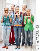 Купить «happy friends covering faces with own photos», фото № 7273493, снято 16 июня 2013 г. (c) Syda Productions / Фотобанк Лори