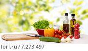 Купить «vegetables, spices and kitchenware on table», фото № 7273497, снято 1 марта 2014 г. (c) Syda Productions / Фотобанк Лори