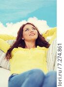 Купить «smiling young woman lying on sofa at home», фото № 7274861, снято 19 марта 2014 г. (c) Syda Productions / Фотобанк Лори