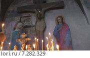 Купить «В церкви. Распятие. За упокой», видеоролик № 7282329, снято 19 апреля 2015 г. (c) Звездочка ясная / Фотобанк Лори