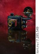 Купить «Ретро-футуристическая модель фотоаппарата на красном», фото № 7285549, снято 6 апреля 2015 г. (c) Валерий Александрович / Фотобанк Лори