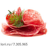 Купить «Salami sausage slices isolated on white background cutout», фото № 7305965, снято 8 декабря 2014 г. (c) Natalja Stotika / Фотобанк Лори