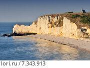 Купить «Chalk cliffs at Cote d'Albatre rocks and natural arch landmark and blue ocean in Etretat. Normandy France.», фото № 7343913, снято 18 июня 2019 г. (c) BE&W Photo / Фотобанк Лори