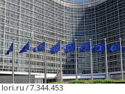 European flags in front of the Berlaymont building headquarters of the European commission in Brussels. Редакционное фото, агентство BE&W Photo / Фотобанк Лори