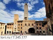 Купить «The Torri Salvucci, Palazzo del Podesta and Torre Grossa, Piazza del Duomo, San Gimignano, Tuscany, Italy», фото № 7345177, снято 25 июня 2019 г. (c) BE&W Photo / Фотобанк Лори