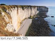 Купить «Chalk cliffs at Cote d'Albatre rocks and natural arch landmark and blue ocean in Etretat. Normandy France.», фото № 7346505, снято 18 июня 2019 г. (c) BE&W Photo / Фотобанк Лори
