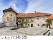 Купить «Slovenia, Bled, Bled Castle, buildings around the lower courtyard.», фото № 7346805, снято 13 декабря 2019 г. (c) BE&W Photo / Фотобанк Лори