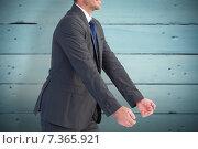 Купить «Composite image of businessman holding something with his hands», фото № 7365921, снято 22 октября 2018 г. (c) Wavebreak Media / Фотобанк Лори