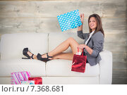 Купить «Composite image of woman lying on couch with shopping bags», фото № 7368681, снято 25 мая 2020 г. (c) Wavebreak Media / Фотобанк Лори