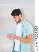 Купить «Composite image of happy casual man sending a text message», фото № 7369857, снято 18 января 2020 г. (c) Wavebreak Media / Фотобанк Лори