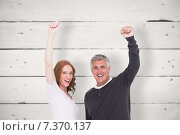 Купить «Composite image of casual couple cheering at camera», фото № 7370137, снято 20 января 2019 г. (c) Wavebreak Media / Фотобанк Лори