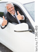Купить «Businessman smiling at camera showing thumbs up», фото № 7380493, снято 15 октября 2014 г. (c) Wavebreak Media / Фотобанк Лори