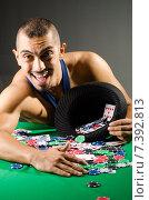 Купить «Man drinking and playing in casino», фото № 7392813, снято 20 сентября 2012 г. (c) Elnur / Фотобанк Лори