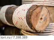 Купить «wooden beam wrapped with rope», фото № 7398389, снято 7 февраля 2015 г. (c) Syda Productions / Фотобанк Лори