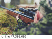 Купить «soldier or hunter shooting with gun in forest», фото № 7398693, снято 14 августа 2014 г. (c) Syda Productions / Фотобанк Лори