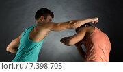 Купить «young men wrestling», фото № 7398705, снято 22 сентября 2014 г. (c) Syda Productions / Фотобанк Лори