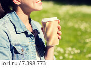 Купить «close up of smiling girl with coffee cup outdoors», фото № 7398773, снято 11 июля 2014 г. (c) Syda Productions / Фотобанк Лори