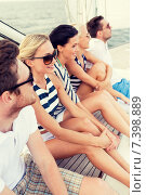 Купить «smiling friends sitting on yacht deck», фото № 7398889, снято 13 июля 2014 г. (c) Syda Productions / Фотобанк Лори
