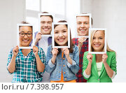 Купить «friends or students covering faces with papers», фото № 7398957, снято 16 июня 2013 г. (c) Syda Productions / Фотобанк Лори