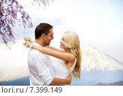 Купить «happy couple hugging over fuji mountain in japan», фото № 7399149, снято 14 июля 2013 г. (c) Syda Productions / Фотобанк Лори
