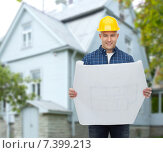 Купить «smiling builder with blueprint over house», фото № 7399213, снято 7 марта 2015 г. (c) Syda Productions / Фотобанк Лори