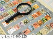 Купить «Коллекция старых почтовых марок и лупа», фото № 7400225, снято 6 мая 2015 г. (c) Дмитрий Бачтуб / Фотобанк Лори