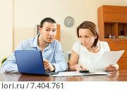 Купить «couple looking financial documents in laptop», фото № 7404761, снято 17 мая 2013 г. (c) Яков Филимонов / Фотобанк Лори