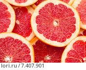 Нарезанный грейпфрут как фон. Стоковое фото, фотограф Ольга Бавыкина / Фотобанк Лори
