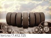 Купить «Шины и шестеренки на фоне облачного неба», иллюстрация № 7412725 (c) Кирилл Черезов / Фотобанк Лори