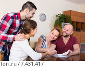 Купить «Two couples discussing and smiling», фото № 7431417, снято 23 июня 2018 г. (c) Яков Филимонов / Фотобанк Лори
