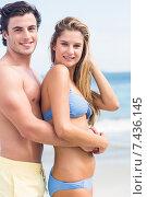 Купить «Happy couple in swimsuit looking at camera and embracing», фото № 7436145, снято 10 марта 2015 г. (c) Wavebreak Media / Фотобанк Лори
