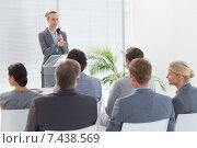 Купить «Pretty businesswoman talking in microphone during conference», фото № 7438569, снято 18 марта 2015 г. (c) Wavebreak Media / Фотобанк Лори