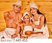 Купить «Group people in hat at sauna.», фото № 7445453, снято 18 ноября 2012 г. (c) Gennadiy Poznyakov / Фотобанк Лори