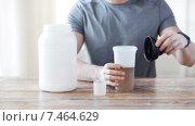 Купить «close up of man with protein shake bottle and jar», видеоролик № 7464629, снято 16 мая 2015 г. (c) Syda Productions / Фотобанк Лори