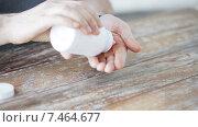 Купить «close up of man pouring pills from jar to hand», видеоролик № 7464677, снято 16 мая 2015 г. (c) Syda Productions / Фотобанк Лори