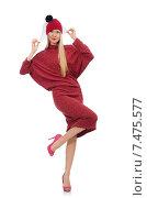 Купить «Pretty young woman in ruby dress isolated on white», фото № 7475577, снято 17 декабря 2014 г. (c) Elnur / Фотобанк Лори