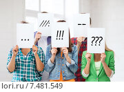 Купить «friends or students covering faces with papers», фото № 7481549, снято 16 июня 2013 г. (c) Syda Productions / Фотобанк Лори