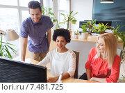 Купить «happy creative team with computer in office», фото № 7481725, снято 29 марта 2015 г. (c) Syda Productions / Фотобанк Лори