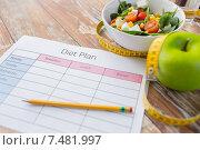 Купить «close up of diet plan and food on table», фото № 7481997, снято 11 марта 2015 г. (c) Syda Productions / Фотобанк Лори