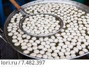 Купить «meat or rice balls frying in oil at street market», фото № 7482397, снято 7 февраля 2015 г. (c) Syda Productions / Фотобанк Лори
